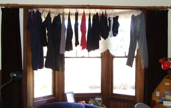 Clothes hanging in the lounge room drying from the warmth from the wood heater