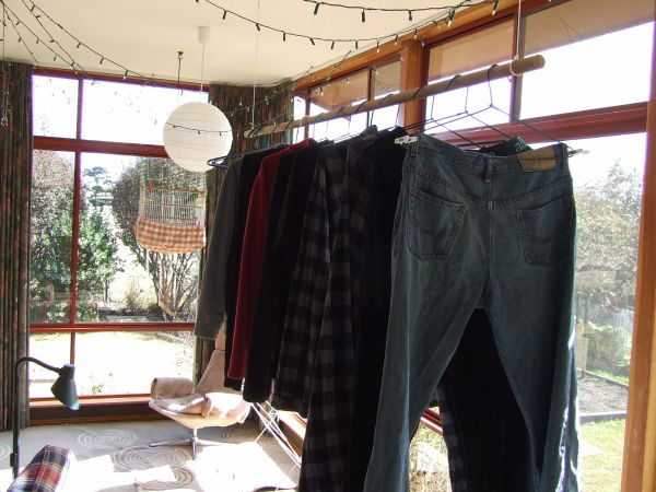 Clothes hanging in the sunroom