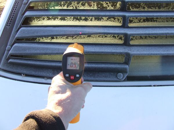 Thermometer pointing to the rear of a car