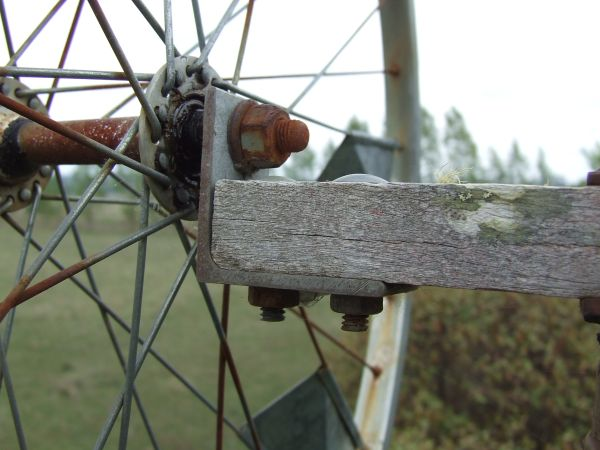the angle iron bracket that is used to mount the wheel to the timber