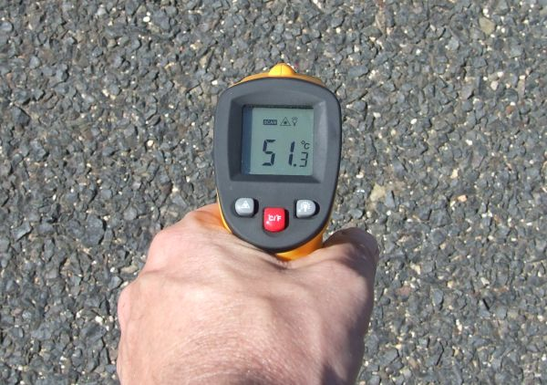 The temperature of the road in front of our house was around 50C.